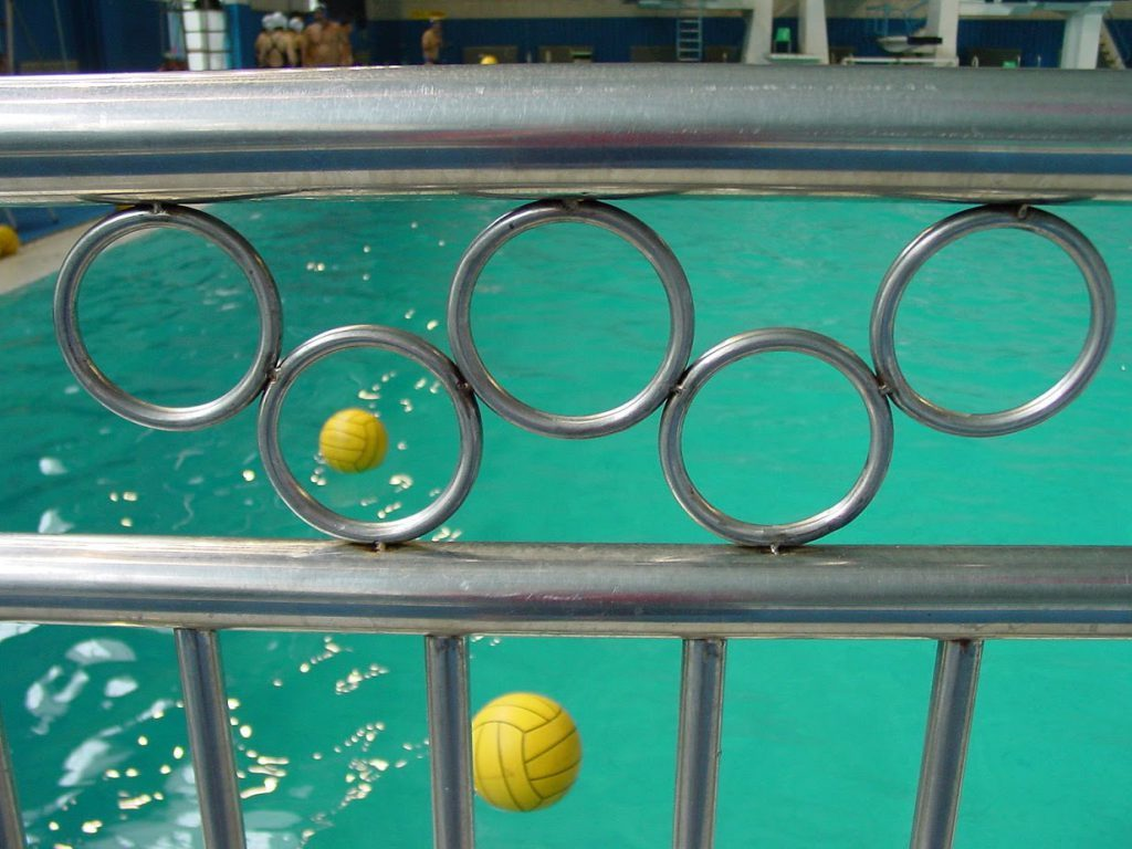 Olympic rings and water polo balls
