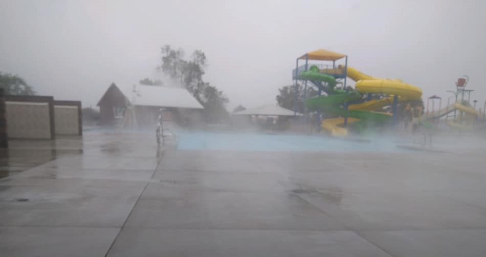 Fog kicks up from the pool